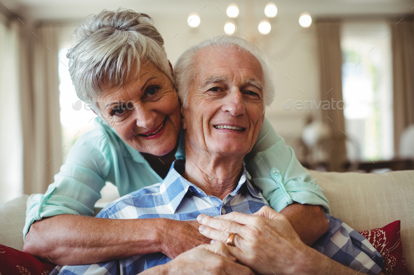 Senior couple relaxing on sofa in living room - Stock Photo - Images