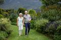 Senior couple walking in lawn - PhotoDune Item for Sale