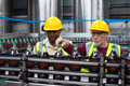 Factory workers monitoring drinks production line - PhotoDune Item for Sale