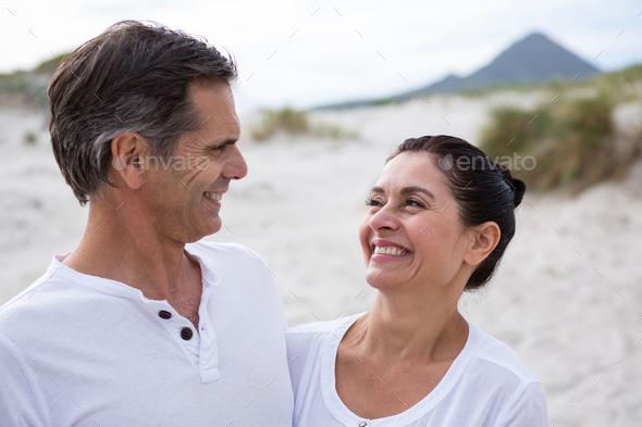 Romantic couple enjoying on beach - Stock Photo - Images