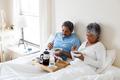 Senior couple having breakfast in bedroom - PhotoDune Item for Sale