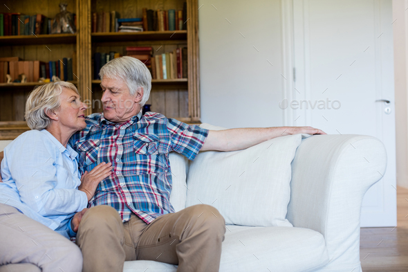Senior couple sitting together on sofa - Stock Photo - Images