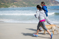 Couple jogging with pet dog - PhotoDune Item for Sale