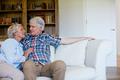 Senior couple sitting together on sofa - PhotoDune Item for Sale