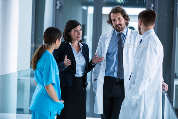 Businesswoman interacting with doctors - Stock Photo - Images