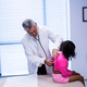 Doctor examining patient with stethoscope - PhotoDune Item for Sale