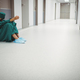 Tensed female surgeon sitting in corridor - PhotoDune Item for Sale