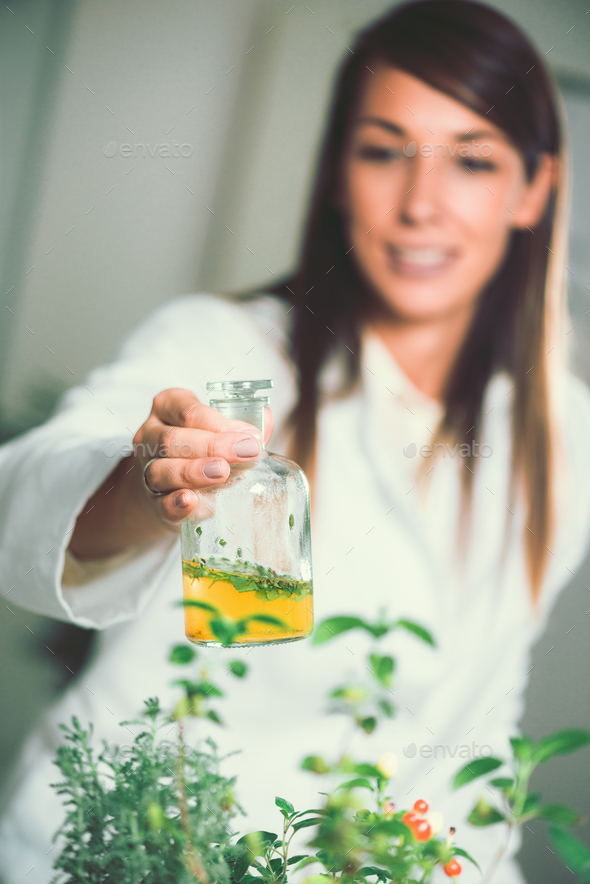 Homeopathy. Homeopath preparing herbal remedies - Stock Photo - Images