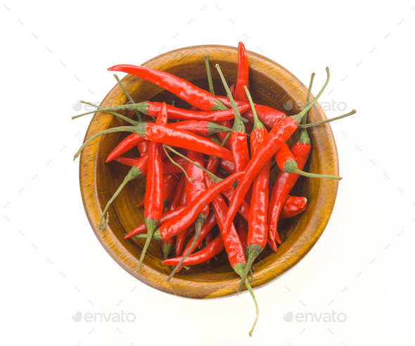 red chillies in wooden bowl isolated on white - Stock Photo - Images