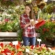 Girl with Tablet Working in Blooming Garden - VideoHive Item for Sale