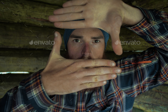 portait of a caucasian male photographer making a composition rectangle sign with his hands - Stock Photo - Images