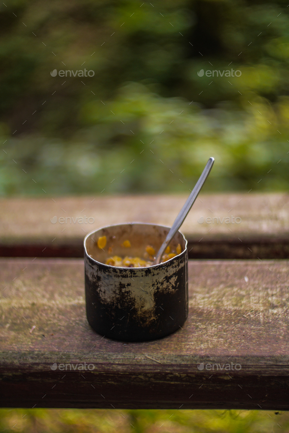 aluminium mug with camping food breakfast - Stock Photo - Images