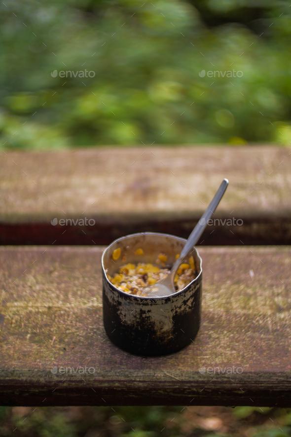 aluminium mug with camping food breakfast - Stock Photo - Images