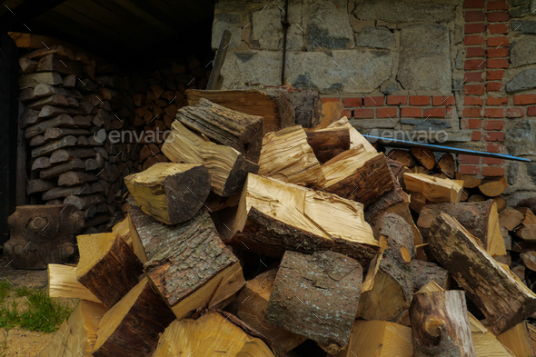 pile of fuel firewood stacked in front of a house - Stock Photo - Images