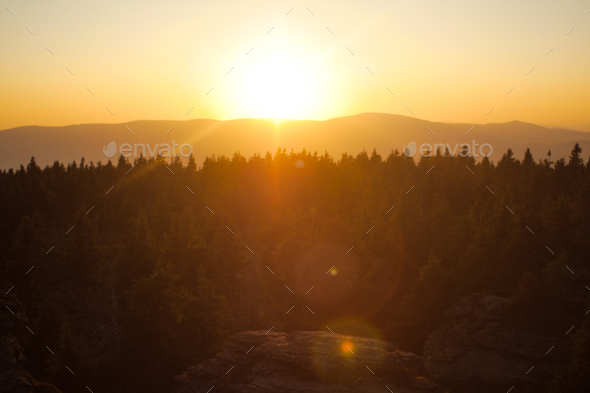 forests, mountains and sunset lensflare - Stock Photo - Images
