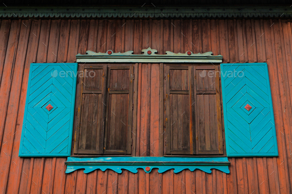 details of a roof on a wooden cabin/ hiking shelter with window and antlers trophy - Stock Photo - Images