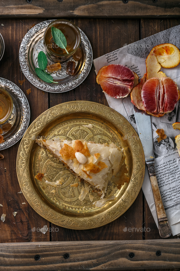 Bastilla pie with tea, moroccan dish, top view - Stock Photo - Images
