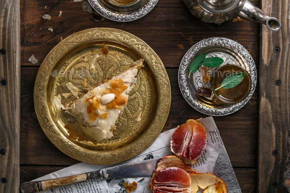Traditional moroccan copper plate with piece of pie - Stock Photo - Images
