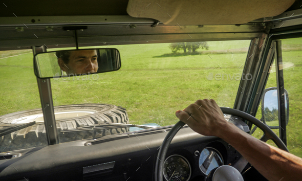 caucasian man driving a off road jeep - Stock Photo - Images