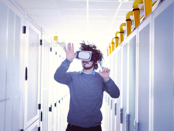 IT engeneer using virtual reality headset - Stock Photo - Images