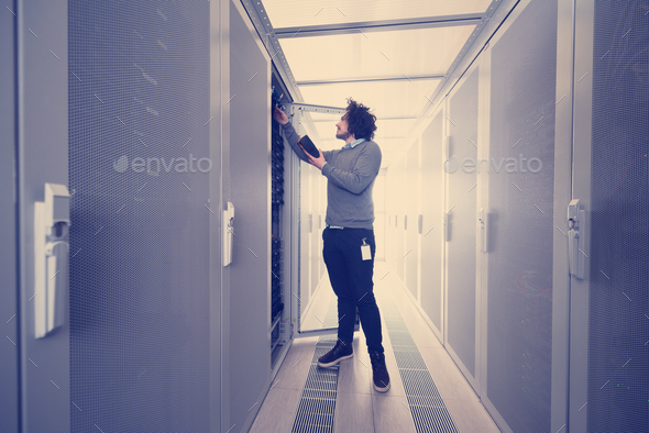 technician using digital cable analyzer - Stock Photo - Images
