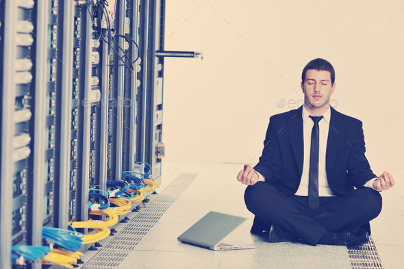 business man practice yoga at network server room - Stock Photo - Images
