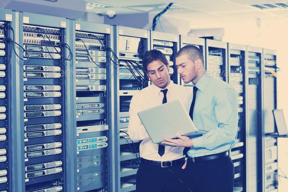 it enineers in network server room - Stock Photo - Images