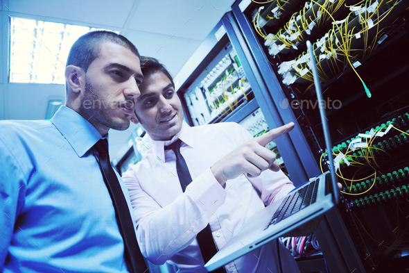 it engineers in network server room - Stock Photo - Images