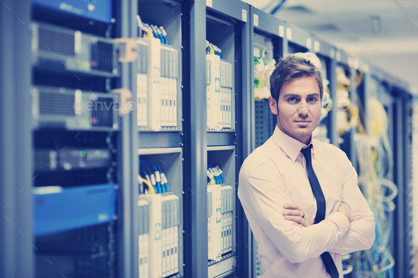 young it engeneer in datacenter server room - Stock Photo - Images