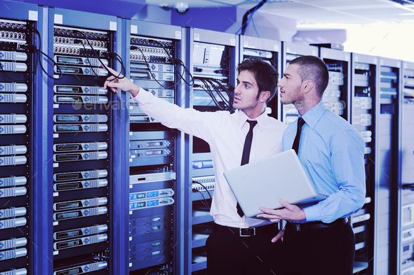 it enineers in network server room - Stock Photo - Images