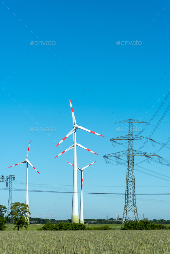 Overhead lines and wind engines on a sunny day  - Stock Photo - Images