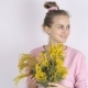 Young Woman with Fresh Mimosa Flowers - VideoHive Item for Sale