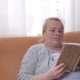 Senior Woman Sitting on Sofa and Reading a Book - VideoHive Item for Sale