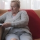 Happy Senior Woman Using Computer Sitting on Sofa - VideoHive Item for Sale