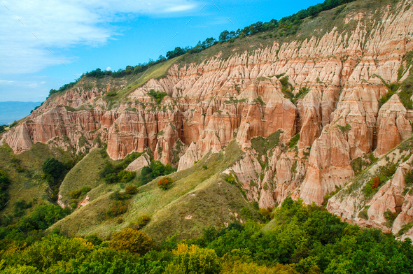 Succession of red and white clays with dinosaur fossils. Geological reserve of Rapa Rosia, Romania - Stock Photo - Images
