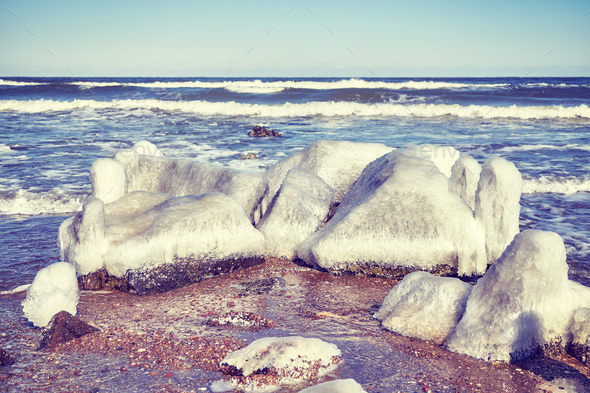 Frozen rocks on a beach, selective focus - Stock Photo - Images