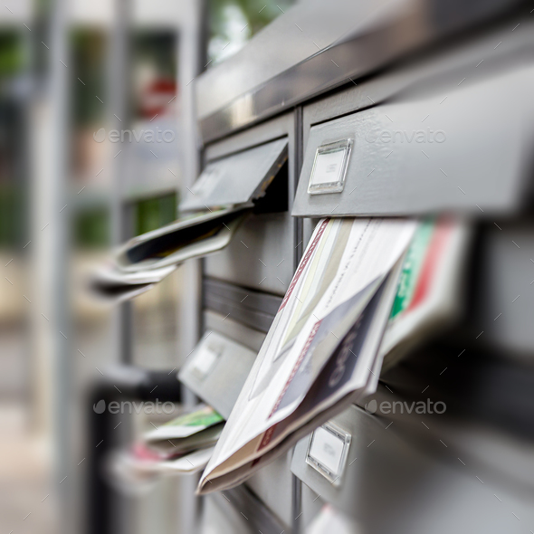 Mail box full of junk mails - Stock Photo - Images