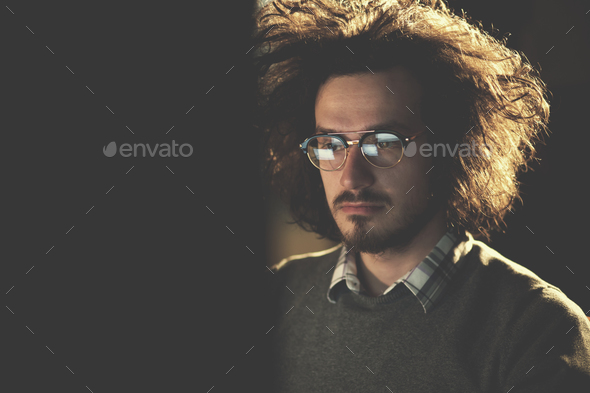 man working on computer in dark office - Stock Photo - Images