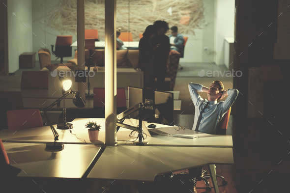 businessman relaxing at the desk - Stock Photo - Images