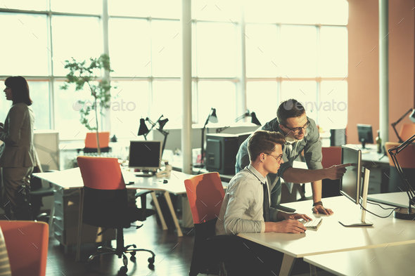 Two Business People Working With computer in office - Stock Photo - Images
