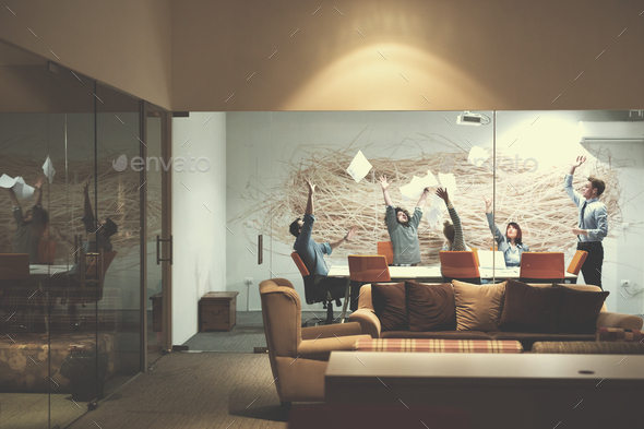 Group of young business people throwing documents - Stock Photo - Images