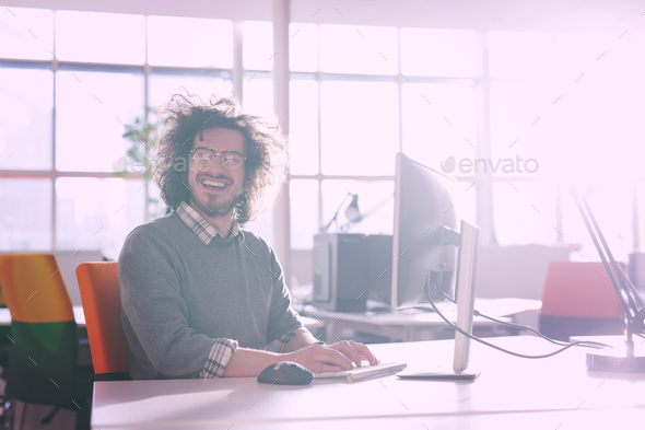 businessman working using a computer in startup office - Stock Photo - Images