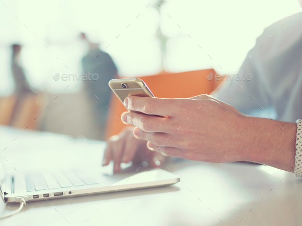Young man holding smartphone - Stock Photo - Images