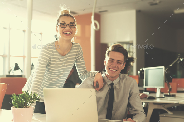 Two Business People Working With laptop in office - Stock Photo - Images