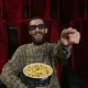 , Happy Face of a Man Enjoying a Movie at the Movie Theatre - VideoHive Item for Sale