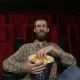 Happy Face of a Man Enjoying a Movie at the Movie Theatre - VideoHive Item for Sale