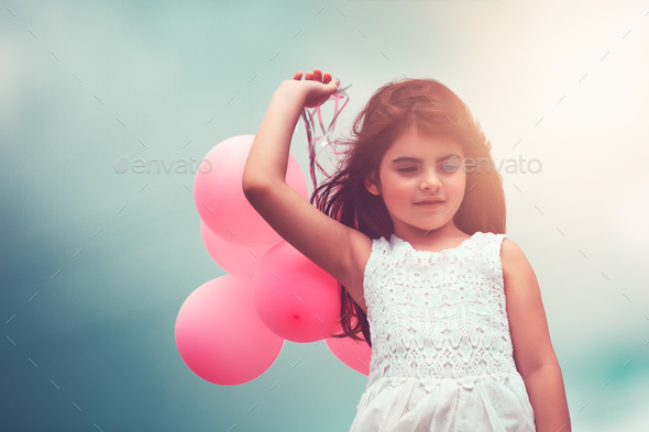 Happy girl with air balloons - Stock Photo - Images