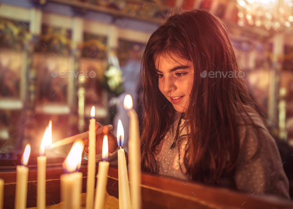 Little girl in the church on Easter - Stock Photo - Images