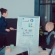 Female Manager Presents New Project Plan To Colleagues at Meeting, Explaining Ideas on Flipchart - VideoHive Item for Sale