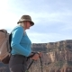 Fat Mature Woman With Trekking Poles And A Backpack Hiking In The Grand Canyon - VideoHive Item for Sale